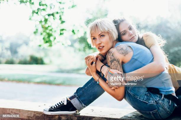Young women sitting in park and resting