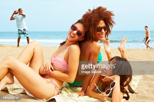 Young women sitting on beach
