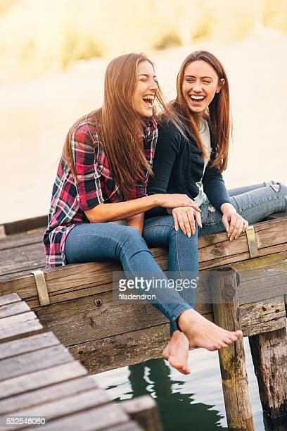 Young women sitting on the pier