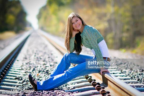 Young Women sitting on tracks