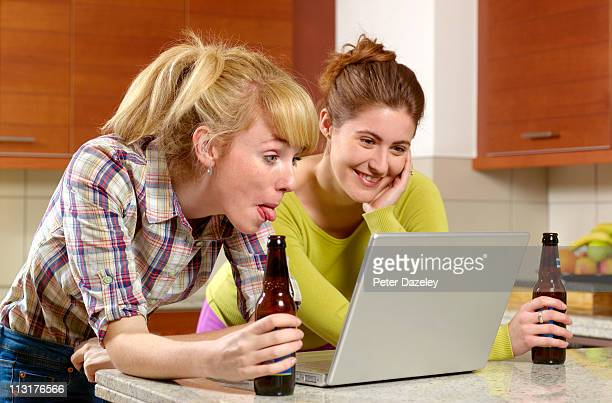 Young women social networking with tongue out