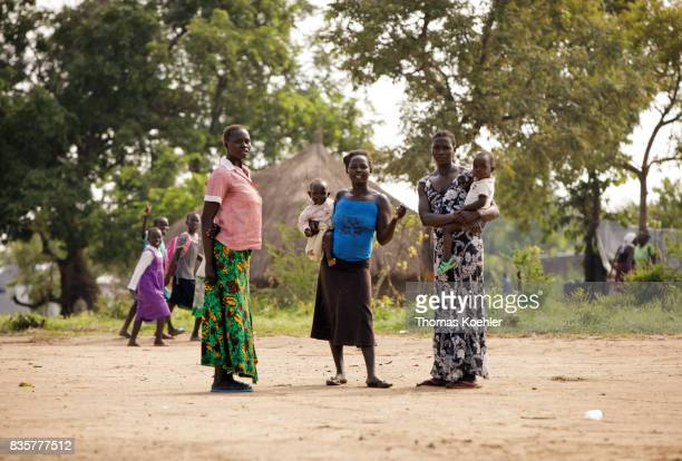 Young women stand with their children on a place at the Rhino Refugee Camp Settlement in northern Uganda The area is home to about 90000 refugees...