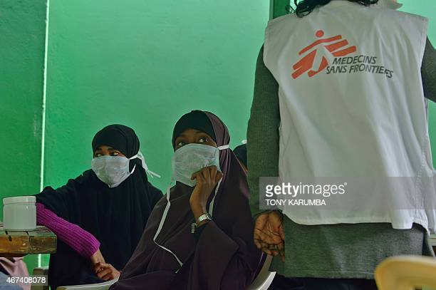 Young women suffering from tuberculosis wait to receive their medication at a Medecins Sans Frontieres run clinic in Nairobi on March 24 World...