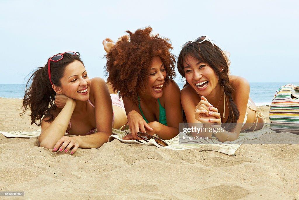 Young women sunbathing on beach