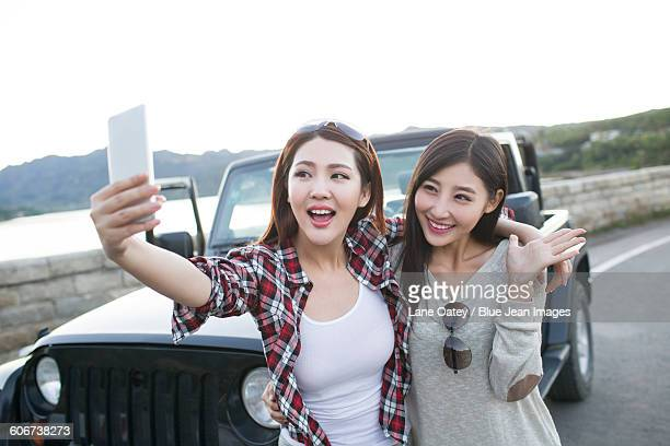 Young women taking self portrait with smart phone