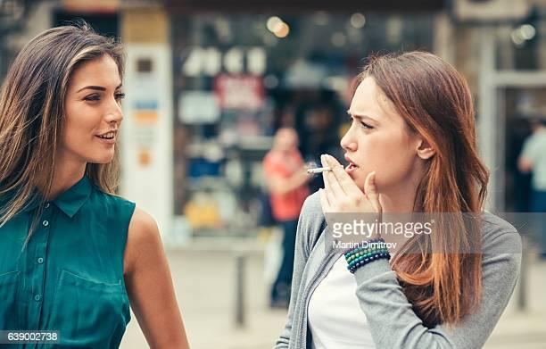 Young women talking outside