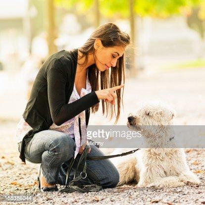 Young women teaching her dog