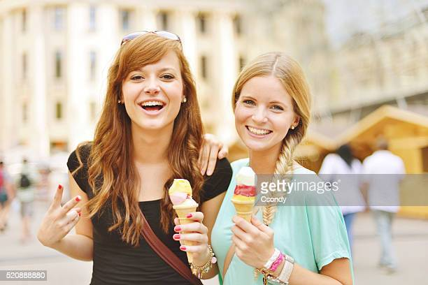 Young women together eating icecream