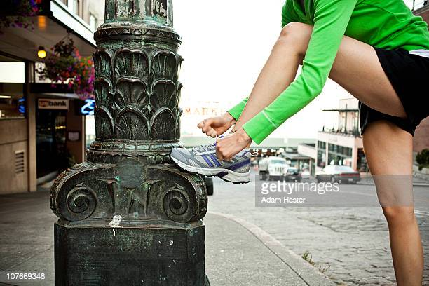 Young women tying her shoelaces.