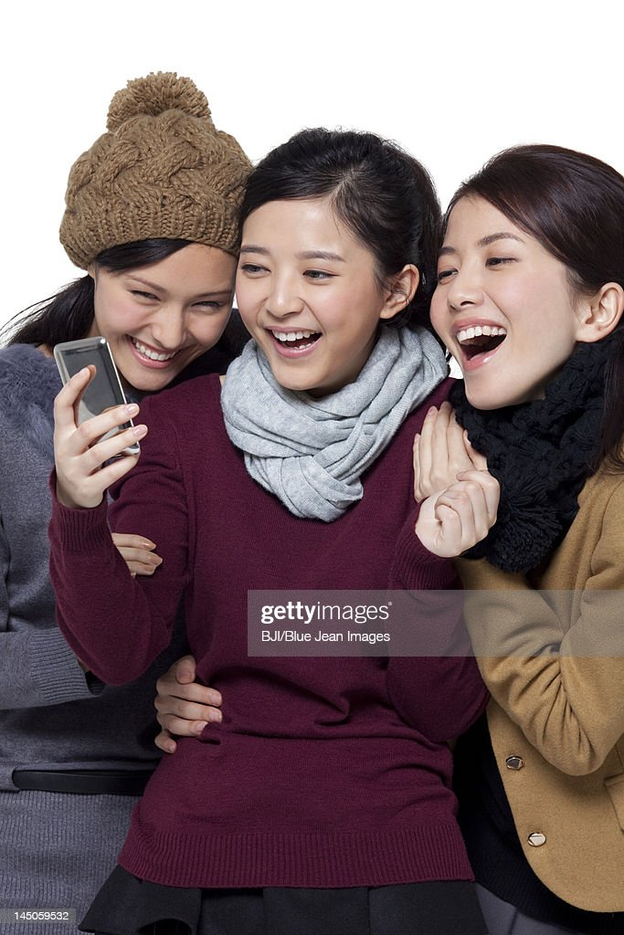 Young women using mobile phone : Stock Photo
