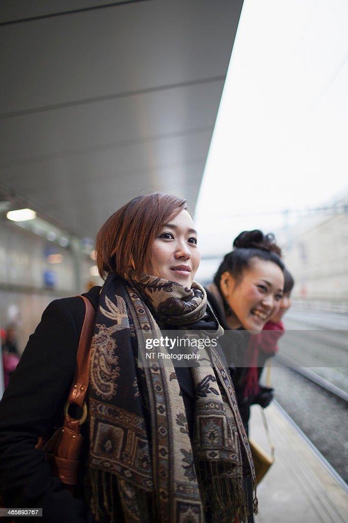 Young women waiting for train : Stock Photo