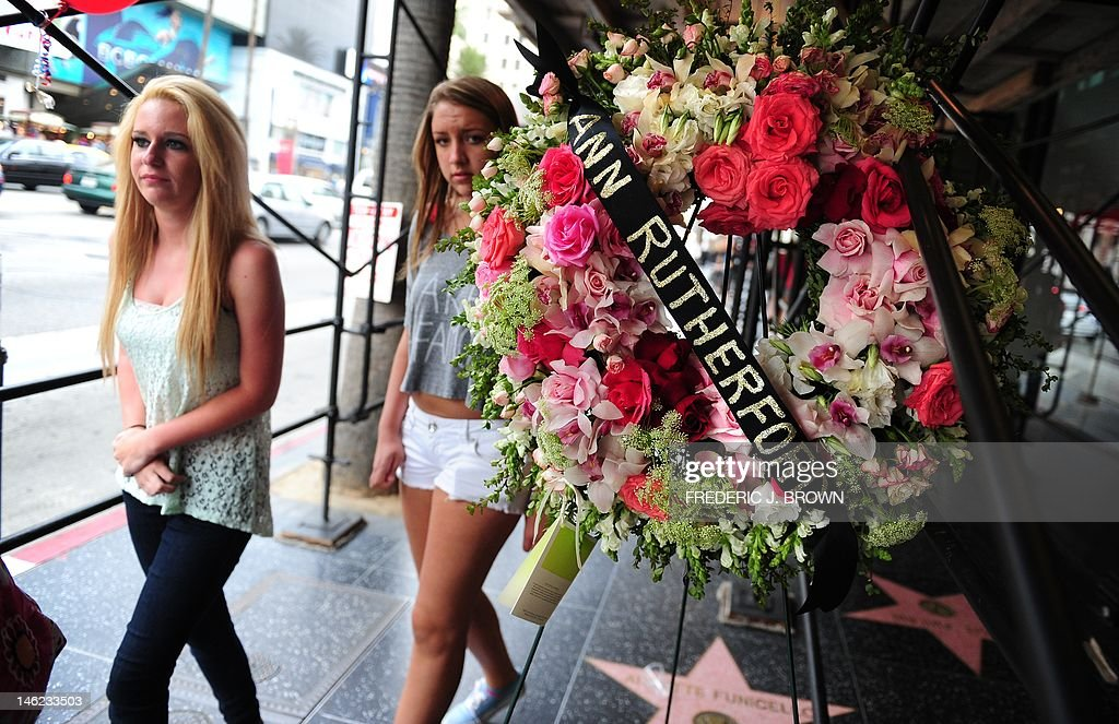 Young women walk past a wreath of flowers placed for the memory of actress Ann Rutherford in Hollywood on June 8, 2012 in California. Rutherford, 94, who played Scarlett's cheery younger sister in the Civil War epic 'Gone with the Wind' has died, according to reports in the Los Angeles Times. A close friend told the daily that Rutherford died Monday night at her home in Beverly Hills after years of heart problems and declining health. Rutherford also appeared in westerns and as Mickey Rooney's teenage girlfriend in the Andy Hardy film series from 1937 to 1958, and on 'The Bob Newhart Show' on television. AFP PHOTO/Frederic J. BROWN