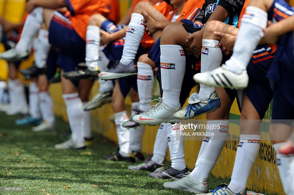 Young women warm up before the 'Mundialito' football tournament in Medellin, Antioquia department, Colombia on June 15, 2010. The 'Mundialito' tournament takes place every four years with the participation of Medellin soccer schools. AFP PHOTO/Raul ARBOLEDA