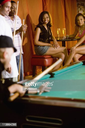 young women watching men shooting pool stock photo getty images young women watching men shooting pool stock photo