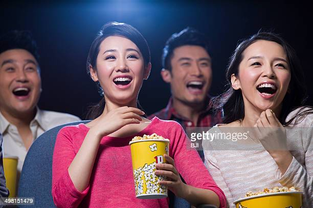 Young women watching movie in cinema