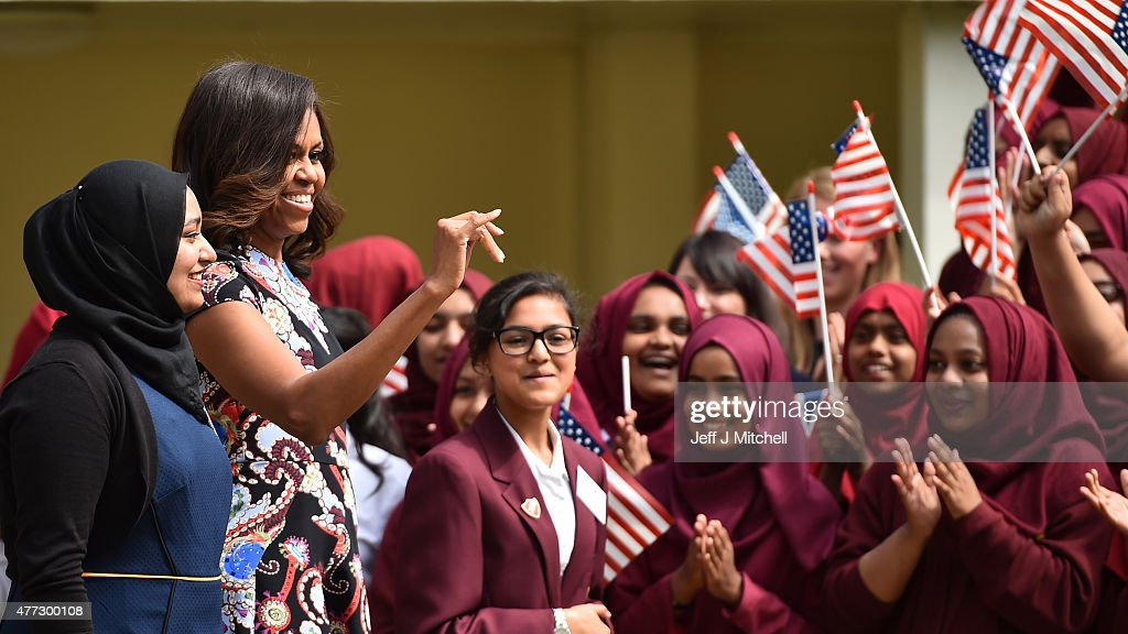 Young women wave the American flag as they greet US First Lady Michelle Obama in the courtyard before an event as part of the 'Let Girls Learn Initiative' at the Mulberry School for Girls on June 16, 2015 in London, England. The US First Lady is travelling with her daughters, Malia and Sasha and her mother, Mrs. Marian Robinson, to continue a global tour promoting her 'Let Girls Learn Initiative'. The event at the school was to discuss how the UK and USA are working together to expand girl's education around the world.