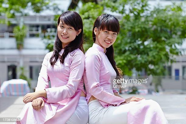 Young women wearing Ao Dai
