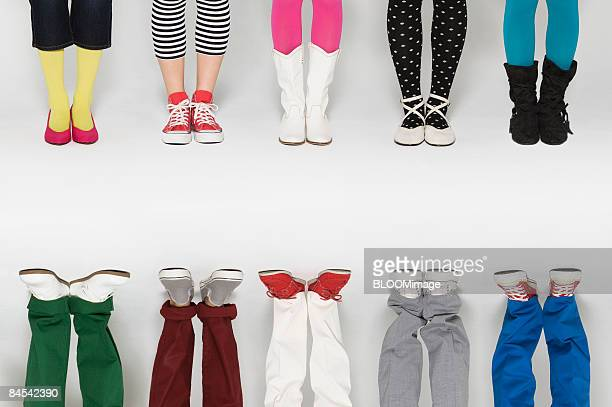 Young women wearing colourful pants, socks and shoes, low section, digital composite