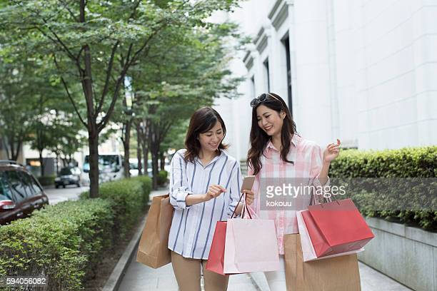 Young women who are looking for shop to see map