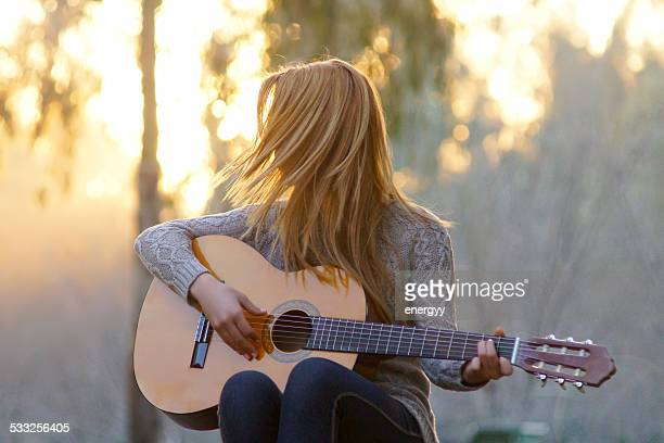 young women with guitar