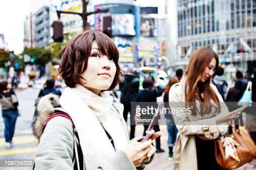 young women with mobile phones : Stock Photo