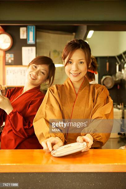 Young women working in restaurant kitchen