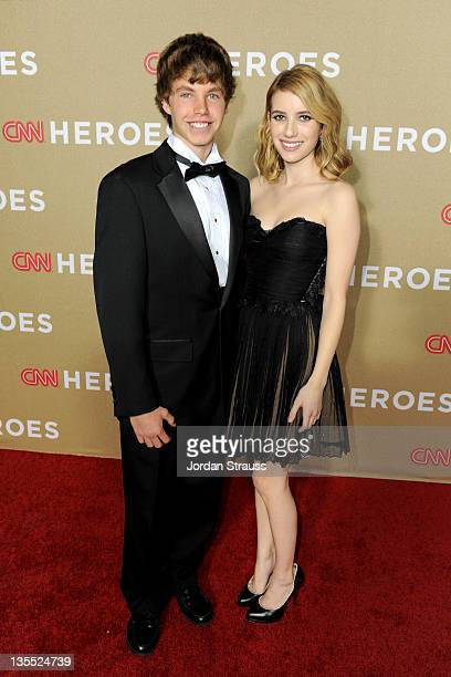 Young wonder Justin Churchman annd actress Emma Roberts pose backstage at 2011 CNN Heroes An AllStar Tribute at The Shrine Auditorium on December 11...