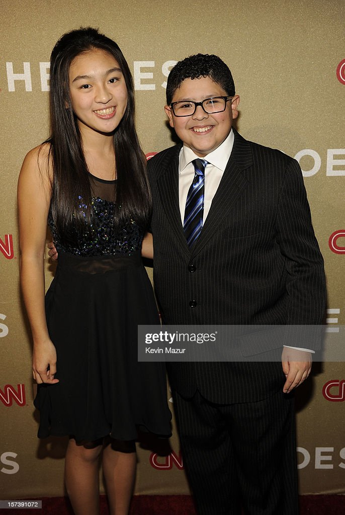 Young Wonders honoree Cassandra Lin (L) and actor Rico Rodriguez attend the CNN Heroes: An All Star Tribute at The Shrine Auditorium on December 2, 2012 in Los Angeles, California. 23046_005_KM_0256.JPG