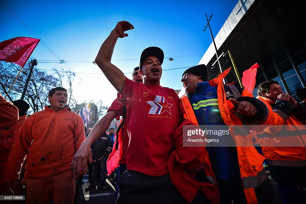 A young worker marching and singing to the Ministry of Economy of Uruguay against the economic policies in Montevideo on June 29, 2016. The PIT-CNT (the only organization of unionized workers of Uruguay) today made a partial strike and marched to front the Ministry of Economy of Uruguay.