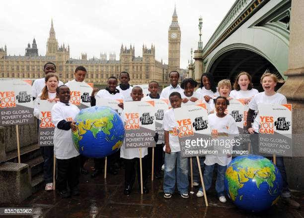 Young World Vision supporters from Luton and Milton Keynes gather with Yes You Can placards and teeshirts by Westminster Bridge prior to joining the...
