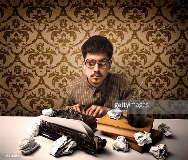 Young writer typing on a typewriter