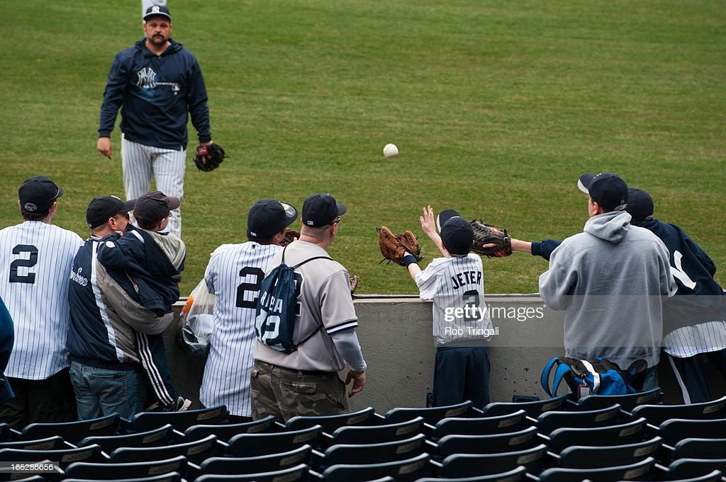 A young Yankee fan makes a catch during batting practice prior to the game between the New York Yankees and the Boston Red Sox on Monday, April 1, 2013 at Yankee Stadium in the Bronx borough of New York.