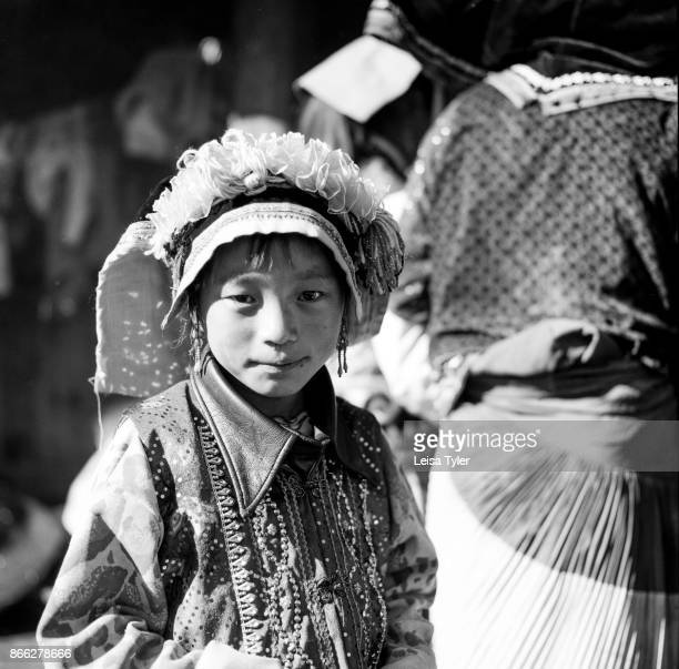 A young Yi girl at a wedding the mountains above Weixi in Yunnan province China The marriage to the boy next door was arranged 15 years prior to the...