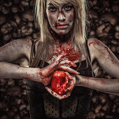 Young Zombie Woman Holding a Human Heart