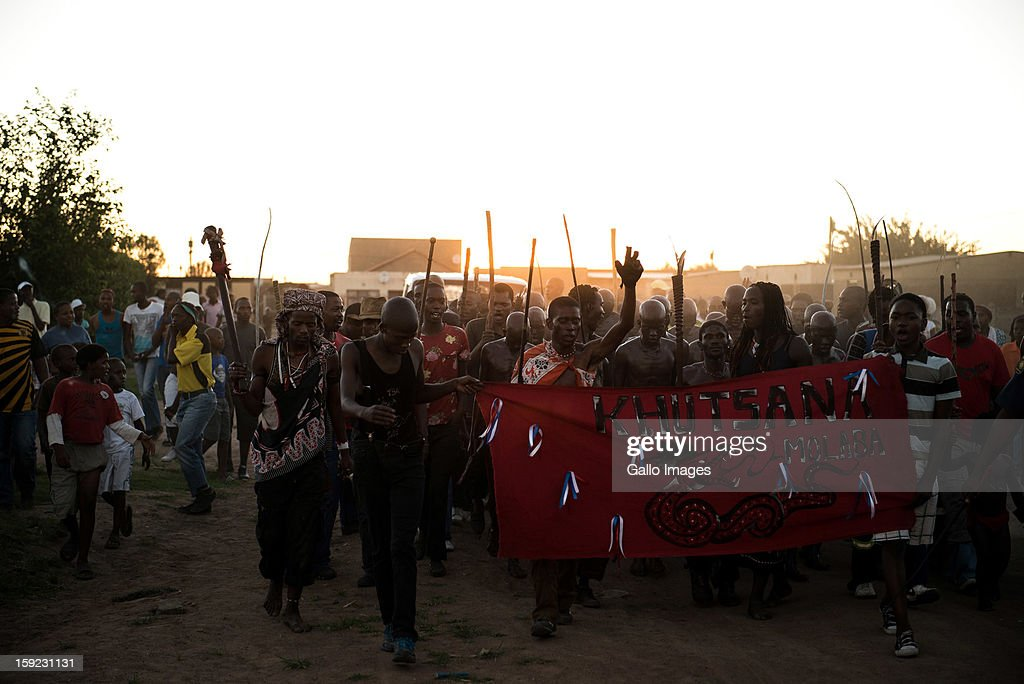 Young Zulu men return home after going through the traditional initiation process on January 4, 2012 in Bophelong, South Africa. In Zulu culture this is considered a coming of age ceremony where a boy enters into manhood. The ritual involves circumcision and cultural instruction regarding their social responsibilities and conduct.