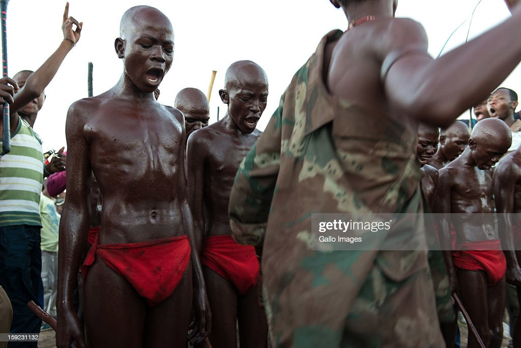 Young Zulu men sing traditional songs after going through the traditional initiation process on January 4, 2012 in Bophelong, South Africa. In Zulu culture this is considered a coming of age ceremony where a boy enters into manhood. The ritual involves circumcision and cultural instruction regarding their social responsibilities and conduct.