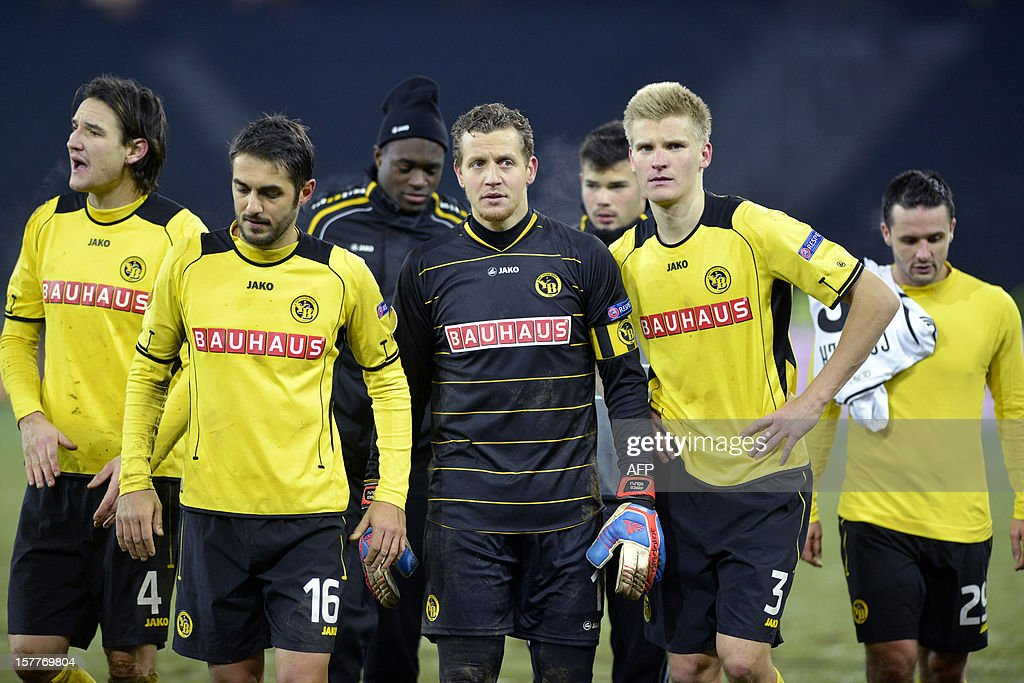 YoungBoys' players Mario Raimondi (2nd L), goalkeeper and captain Marco Wolfli (C), Juhani Ojala (Front R) and Raphael Nuzzolo (Back R) celebrate their victory at the end of the Europa League group A football match between BSC Young Boys and FC Anji Makhachkala on Decenber 6, 2012, in Bern. Despite winning the match the YoungBoys did not qualify for the next round of the Europa League championship.