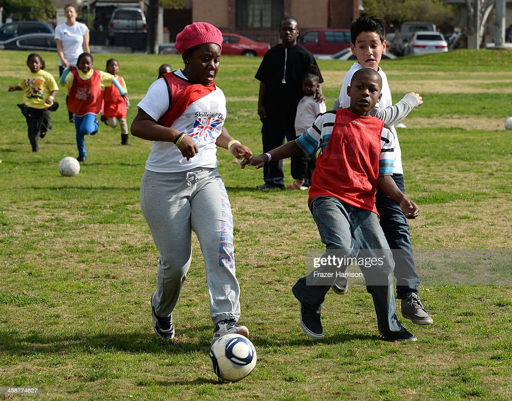 Youngers play soccer at the BAFTA LA Inner City Christmas Party at Athens Park, on December 21, 2013 in Los Angeles, California.