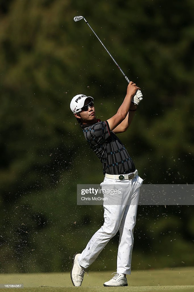 Young-Han Song of Korea plays his second shot on the 15th hole during day three of the Panasonic Japan Open at Ibaraki Golf Club on September 28, 2013 in Ibaraki, Japan.
