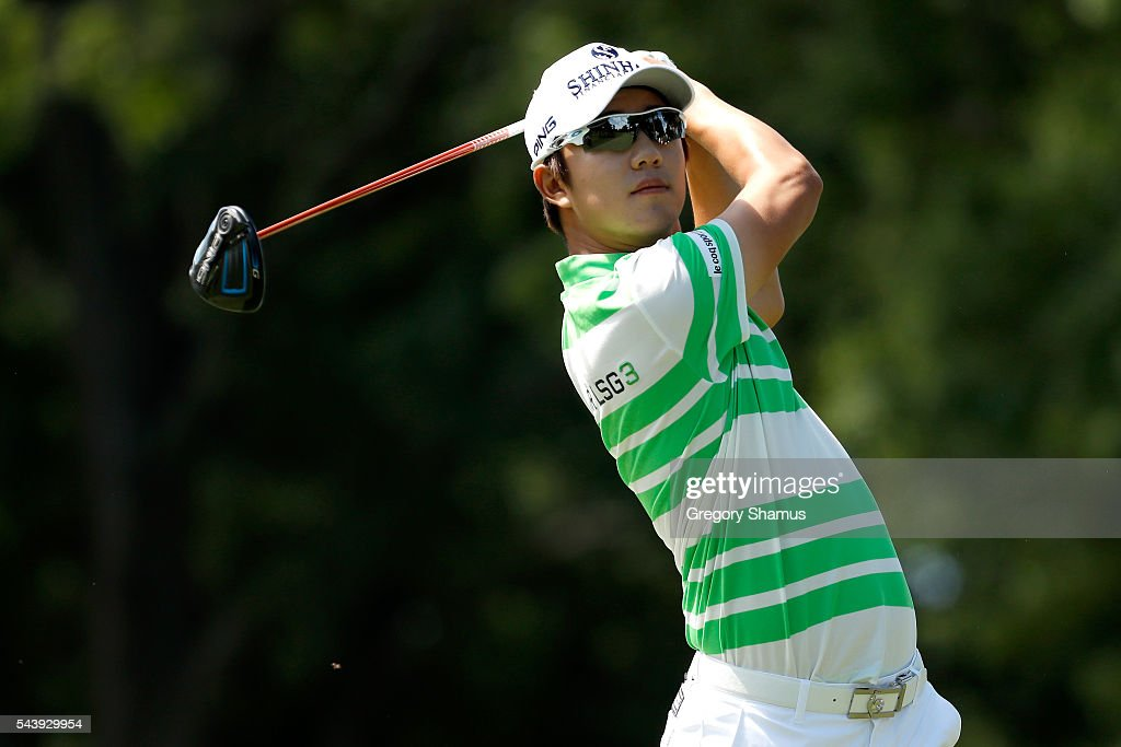 Young-han Song of South Korea hits off the third tee during the first round of the World Golf Championships - Bridgestone Invitational at Firestone Country Club South Course on June 30, 2016 in Akron, Ohio.