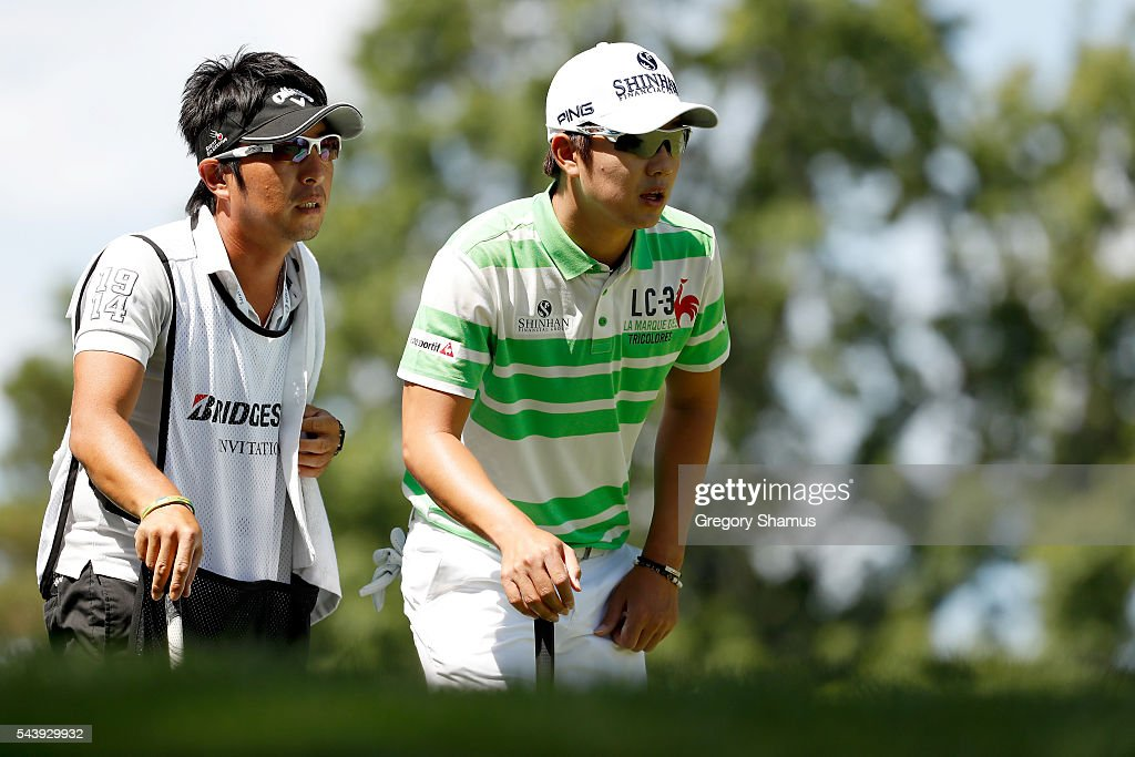 Young-han Song of South Korea lines up a putt on the second green during the first round of the World Golf Championships - Bridgestone Invitational at Firestone Country Club South Course on June 30, 2016 in Akron, Ohio.