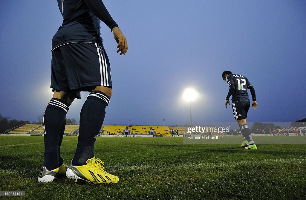 Young-Pyo Lee #12 of the Vancouver Whitecaps FC and teammate Camilo Sanvezzo #7 wait during the second half of a game against the Chicago Fire at Blackbaud Stadium on February 23, 2013 in Charleston, South Carolina.