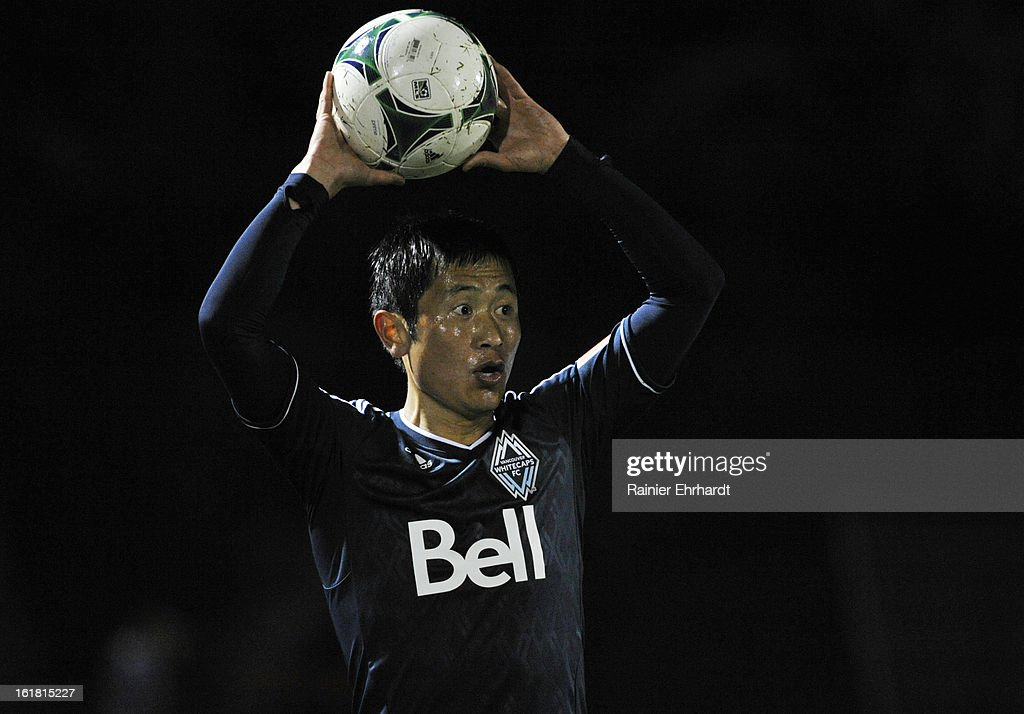 YoungPyo Lee of the Vancouver Whitecaps FC looks to throw the ball in during the first half of their game against the Charleston Battery in the...