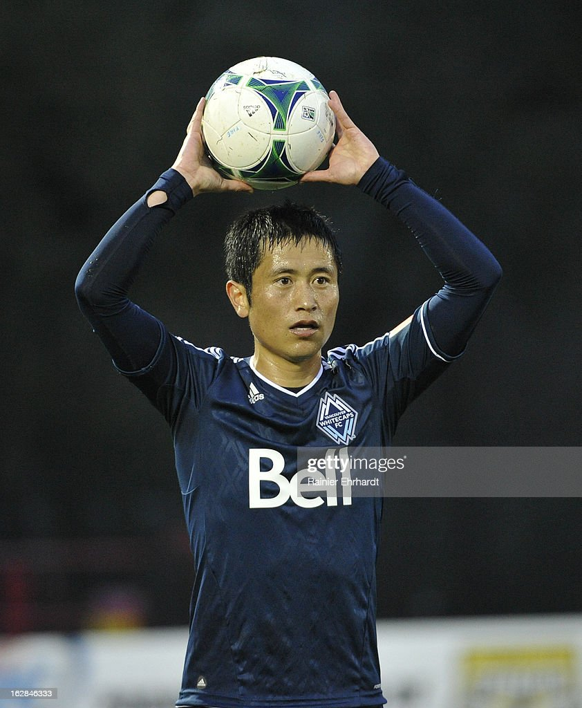 YoungPyo Lee of the Vancouver Whitecaps FC prepares to throw in the ball during the second half of the Carolina Challenge Cup against the Chicago...