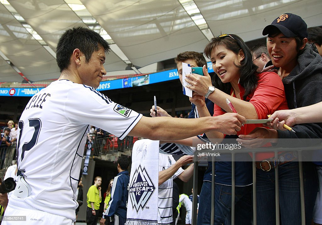 YoungPyo Lee of the Vancouver Whitecaps FC signs autographs for fans after their MLS game against the Houston Dynamo June 10 2012 in Vancouver...