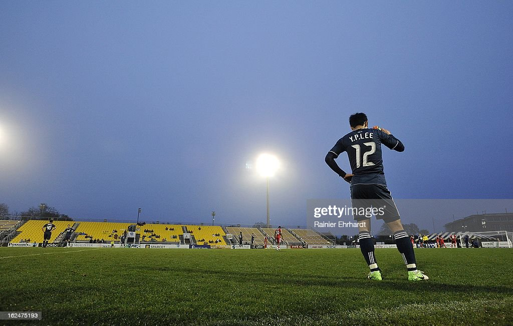 Young-Pyo Lee #12 of the Vancouver Whitecaps FC waits during the second half of a game against the Chicago Fire at Blackbaud Stadium on February 23, 2013 in Charleston, South Carolina.