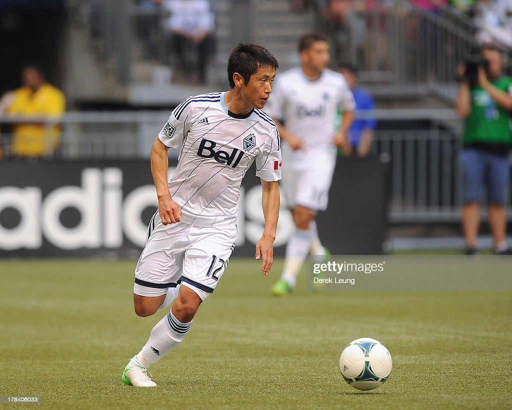 YoungPyo Lee of the Vancouver Whitecaps in action during an MLS match against the San Jose Earthquakes at BC Place on August 10 2013 in Vancouver...