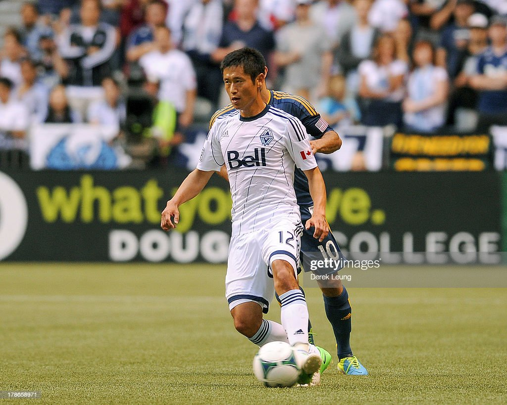 YoungPyo Lee of the Vancouver Whitecaps in action during an MLS match against the Los Angeles Galaxy at BC Place on August 24 2013 in Vancouver...