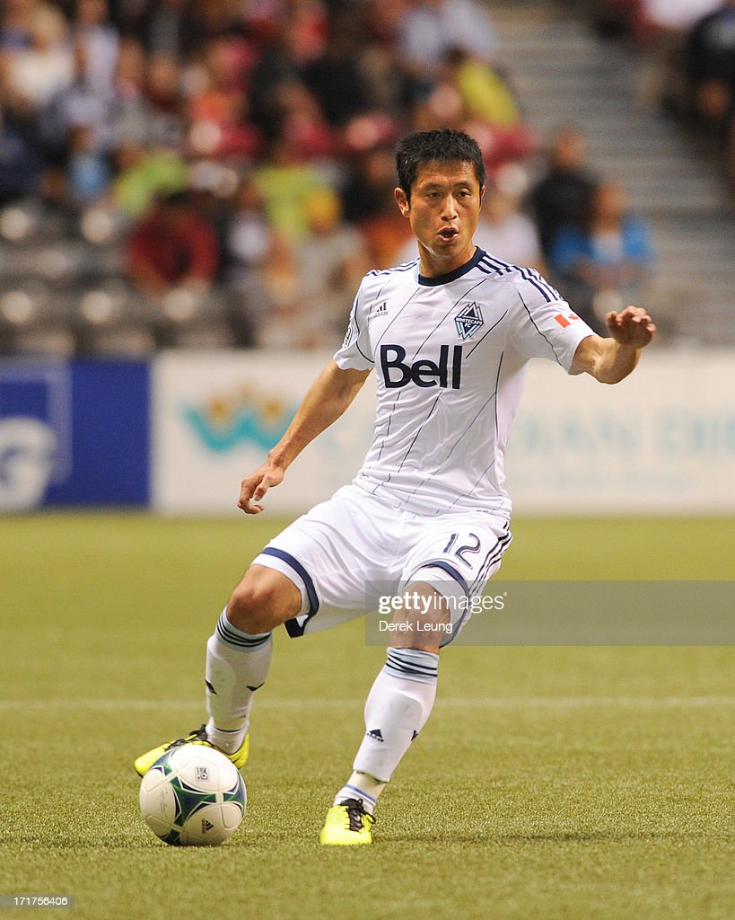 YoungPyo Lee of the Vancouver Whitecaps runs against Chivas USA during an MLS Match at BC Place on June 19 2013 in Vancouver British Columbia Canada...