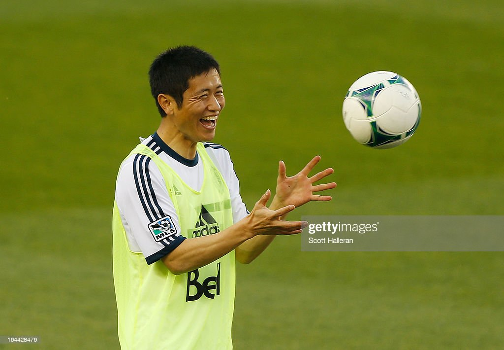 YoungPyo Lee of the Vancouver Whitecaps works out on the field prior to the start of the game against the Houston Dynamo during an MLS match at BBVA...